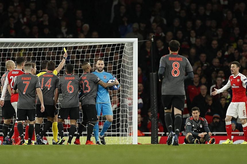 Irate fans making a stand and voicing their unhappiness at the way Arsenal's season is unravelling by protesting against long-time manager Arsene Wenger. Laurent Koscielny conceding the foul, which led to his red card and Robert Lewandowski's 55th-mi