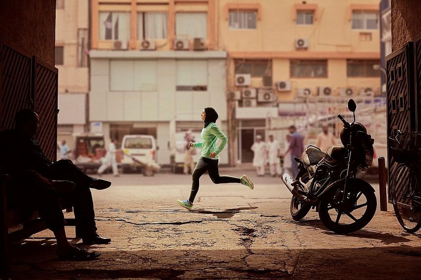 Emirati figure skater Zahra Lari running in Dubai for a Nike advertisement. The US firm has unveiled a hijab for Muslim women athletes.