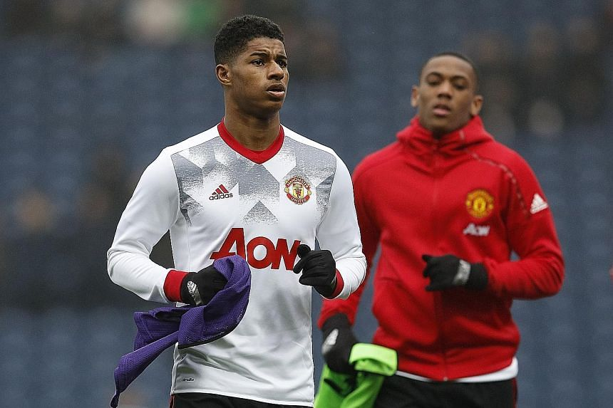 United forwards Marcus Rashford (left) and Anthony Martial look to take up the scoring mantle in the absence of skipper Wayne Rooney.