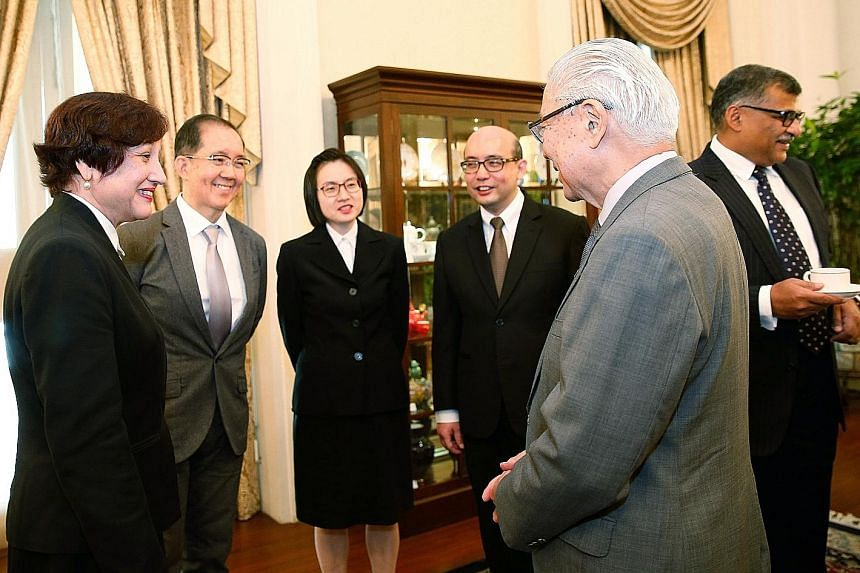 President Tony Tan Keng Yam speaking with (from left) Judges of Appeal Judith Prakash and Tay Yong Kwang, and Judicial Commissioners Audrey Lim Yoon Cheng and Pang Khang Chau, with Chief Justice Sundaresh Menon in the background, at the Istana last y