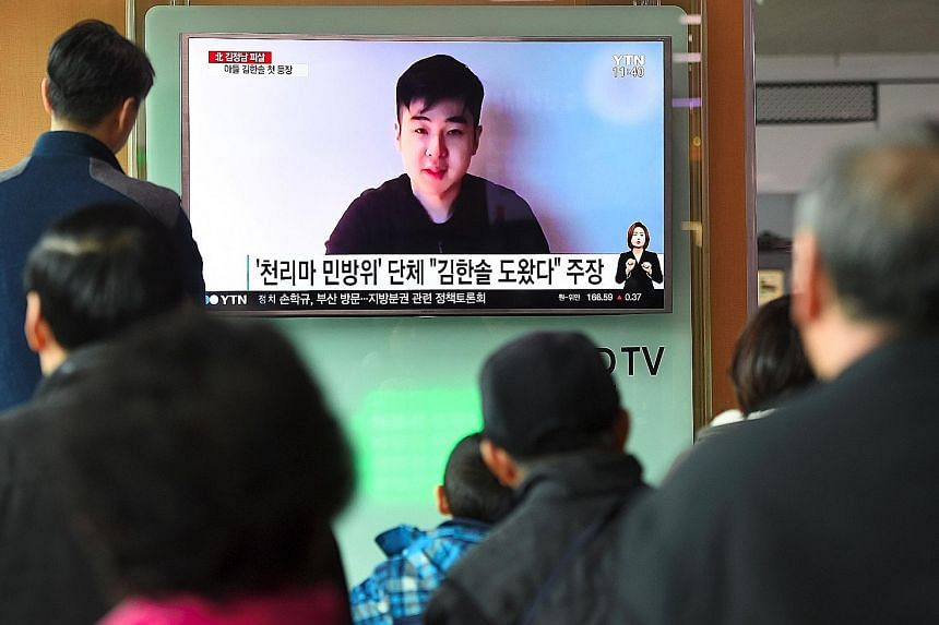 A TV news report in Seoul yesterday showing the video in which Mr Kim Han Sol speaks about his father's murder and says he is with his mother and sister.