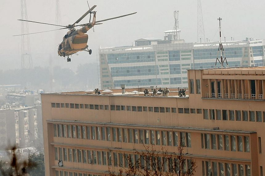 Afghan special forces soldiers used helicopters to mount a counter-attack at the Sardar Mohammad Daud Khan hospital from the roof. Some patients climbed out of the building and could be seen sheltering on window ledges. Away from Kabul, the country h