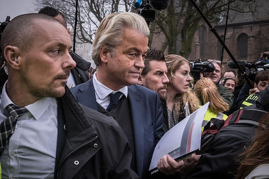 Mr Geert Wilders (second from left), leader of the far-right Party for Freedom, at a campaign stop in Spijkenisse, the Netherlands, on Feb 18. His outspoken anti-European Union and anti-Islam views have attracted so much financial support from like-m
