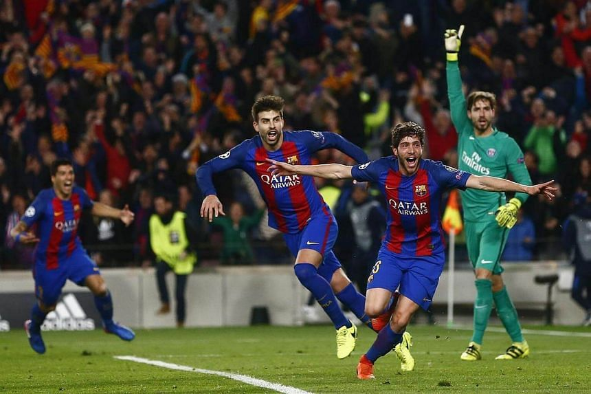 Barcelona's midfielder Sergi Roberto (second from right) celebrates after scoring their sixth goal against PSG.