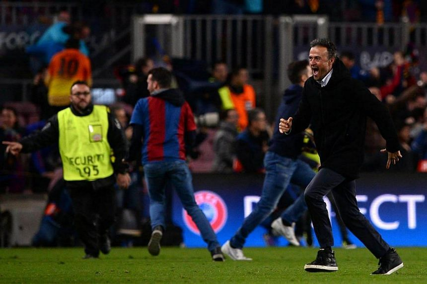Barcelona's coach Luis Enrique (right) celebrates their 6-1 victory at the end of the Uefa Champions League round of 16 football match between Barcelona and Paris Saint-Germain.