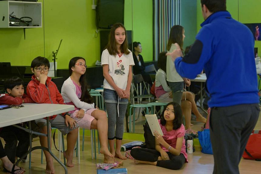 Children hoping to enter the School of the Arts (Sota) at a preparatory camp at the Kids Performing Academy of the Arts on June 6, 2014. Sota is one of the schools here that accepts students via the direct school admissions (DSA) route.