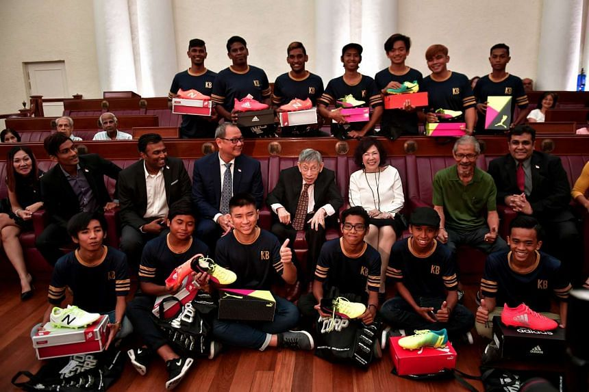 Mr Chiam See Tong, his wife Lina and members of the board with youths from Pekik, a beneficiary of the newly launched Chiam See Tong Sports Foundation, at the Arts House on March 9, 2017.