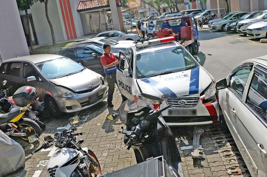 A police car was involved in an accident with three other cars and three motorcycles parked at a Jurong East carpark on the morning of March 9, 2017.