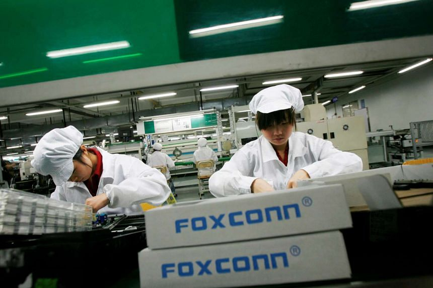 Employees work inside a Foxconn factory in the township of Longhua in Guangdong, China, on May 26, 2010.