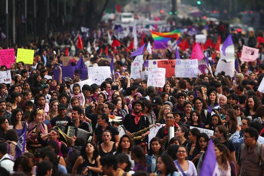 Demonstrators take part in a march on International Women's Day in Mexico City.