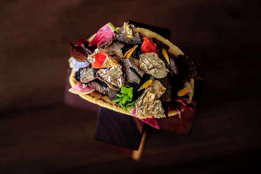 The taco, which is prepared by the resort's chef with corn tortilla, golden flakes, shrimps, Kobe meat, Beluga caviar, black truffle, Brie cheese and a special hot sauce, costs US$25,000 (S$35,432).