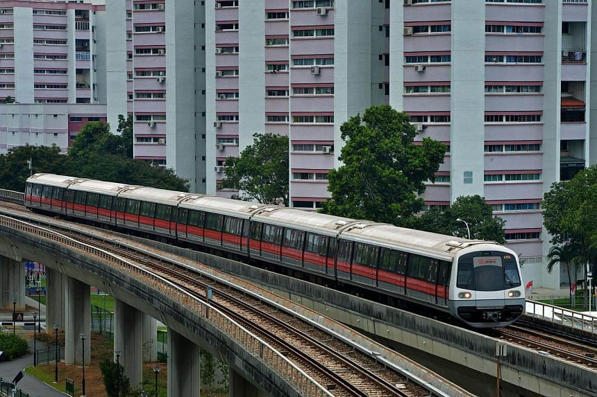 An SMRT train travelling westward from Eunos MRT station to Paya Lebar MRT station.