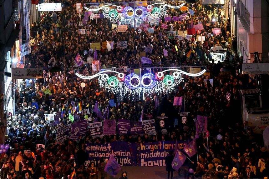 Thousands of women shouting slogans and holding placards against the upcoming referendum on the presidential reform during a rally at Istiklal Street on International Women's Day in Istanbul, Turkey.