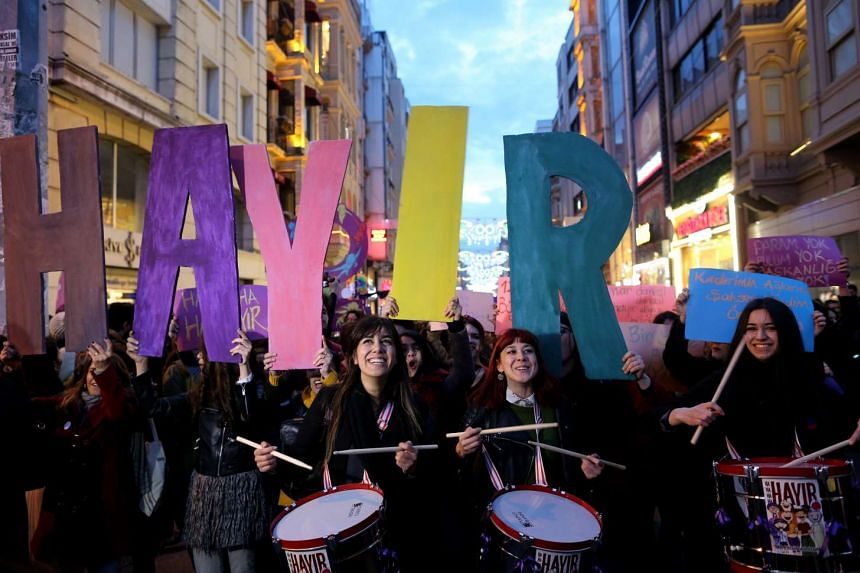 Women shouting slogans and holding letters forming the phrase 'vote no' in the upcoming referendum on the presidential reform during a rally at Istiklal Street on International Women's Day in Istanbul, Turkey.