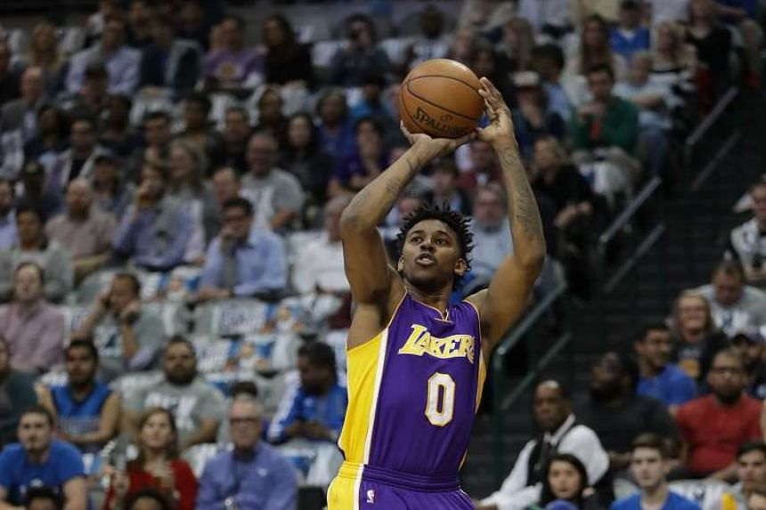 Los Angeles Lakers player Nick Young in a match against the Dallas Mavericks.