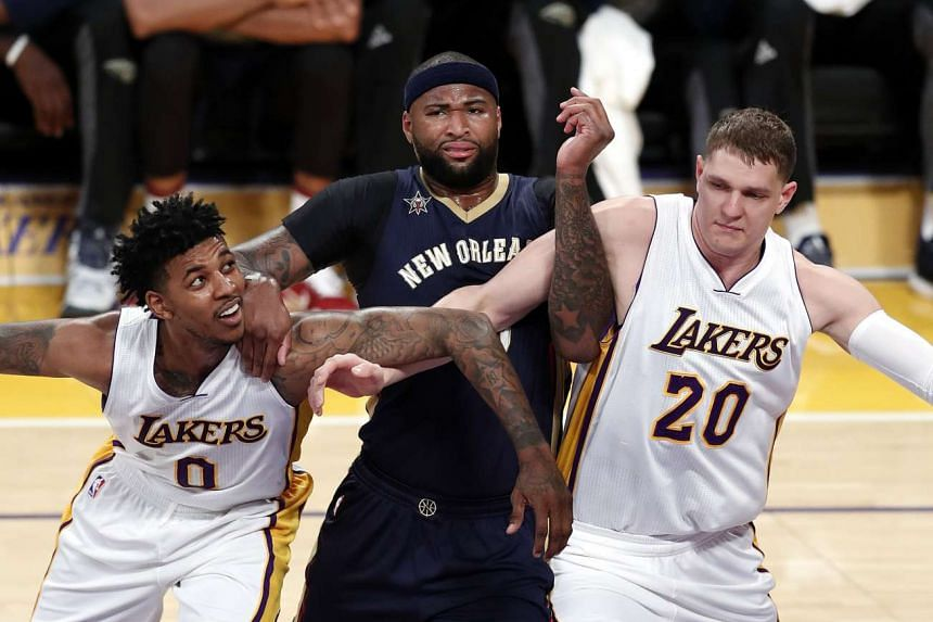 New Orleans Pelicans forward DeMarcus Cousins (middle) in a match against the Los Angeles Lakers.