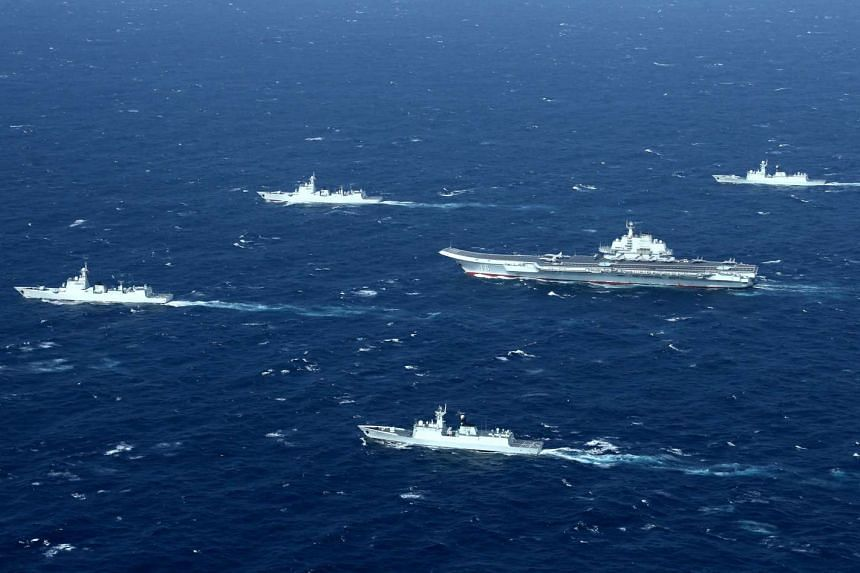 China's Liaoning aircraft carrier with accompanying fleet.