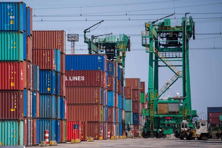 Containers organised in stacks at the Shanghai Waigaoqiao Free Trade Zone in Shanghai on March 6, 2017.