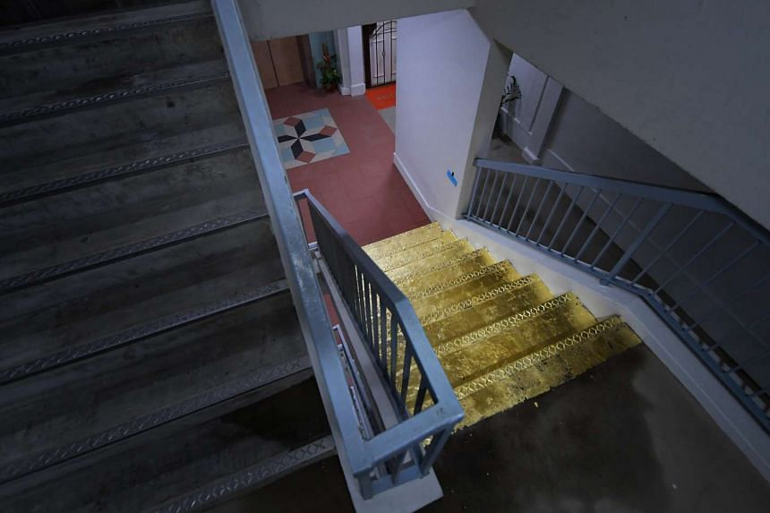 """The """"golden staircase"""" is on the 20th floor of Block 103 Jalan Rajah."""