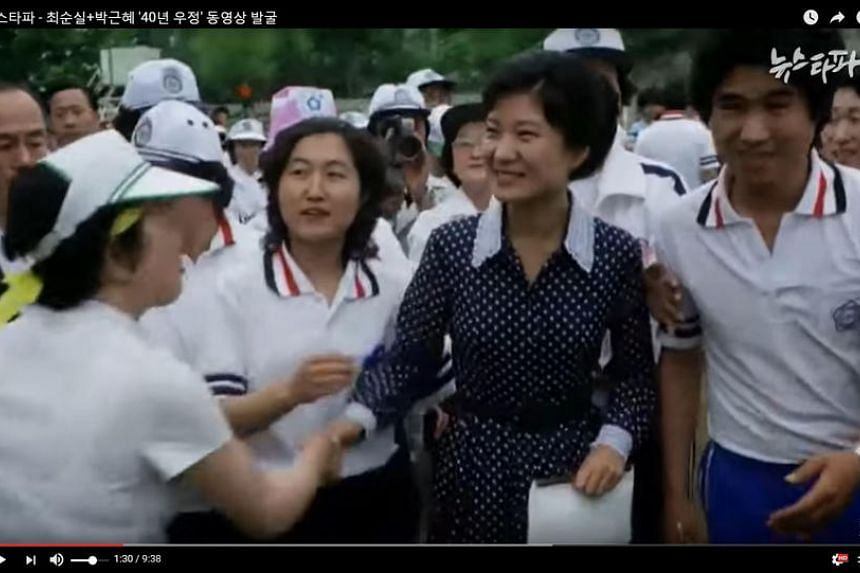 An image taken from footage released by internet media outlet Newstapa shows Park Geun Hye (right) and Choi Soon Sil at a university campus in Seoul in June 1979 where Park attended a public event.