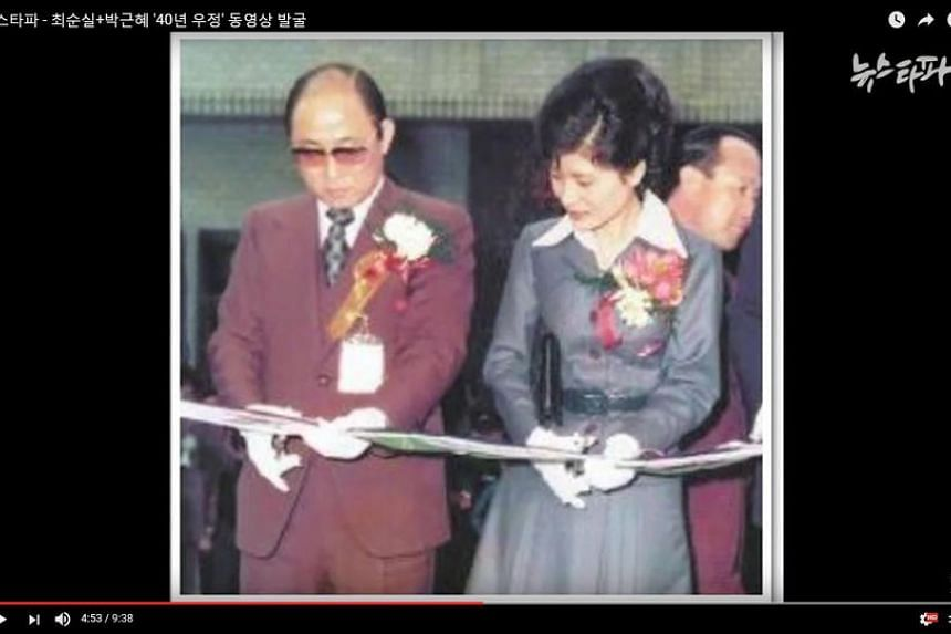 An undated image taken from footage released by internet media outlet Newstapa shows Park Geun Hye (right) with Choi Tae Min,  founder of a cult-like group and father of Choi Soon Sil.