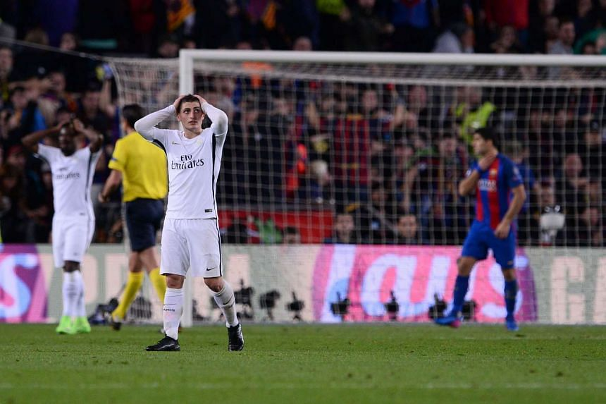 Paris Saint-Germain's midfielder Marco Verratti reacts on the pitch after Barcelona's midfielder Sergi Roberto scored his team's victory goal during the UEFA Champions League round match on March 8, 2017.