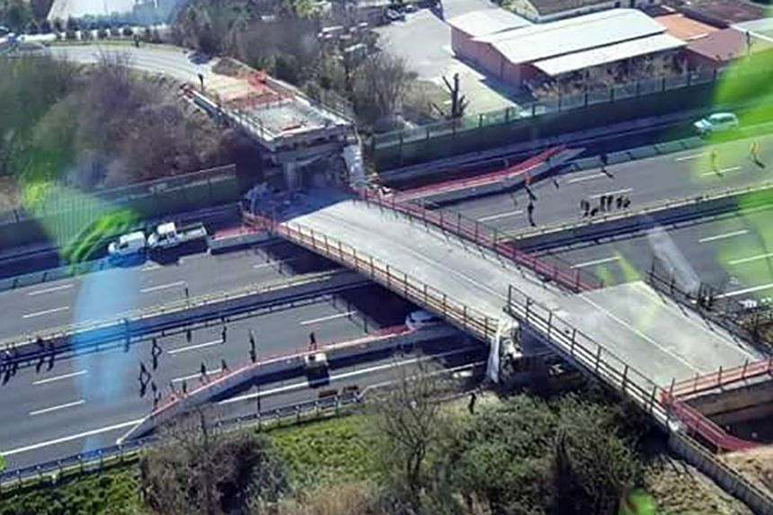 A police photo shows a motorway bridge after it collapsed, killing at least two people and injuring two others.