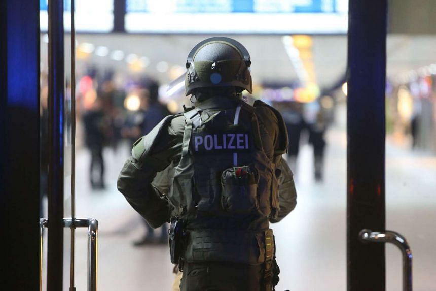 Special police commandos arriving at the main train station in Duesseldorf, Germany.