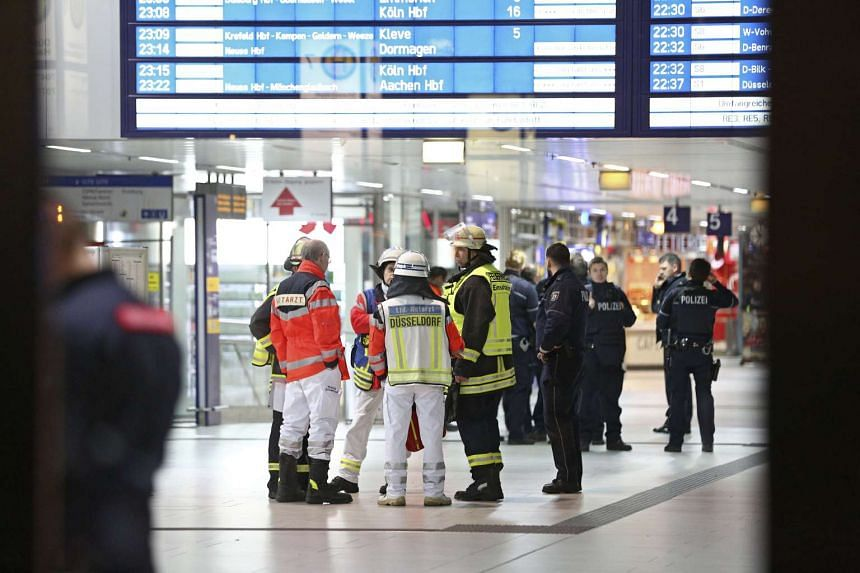 Paramedics at the scene of crime in the central station of Duesseldorf, Germany.
