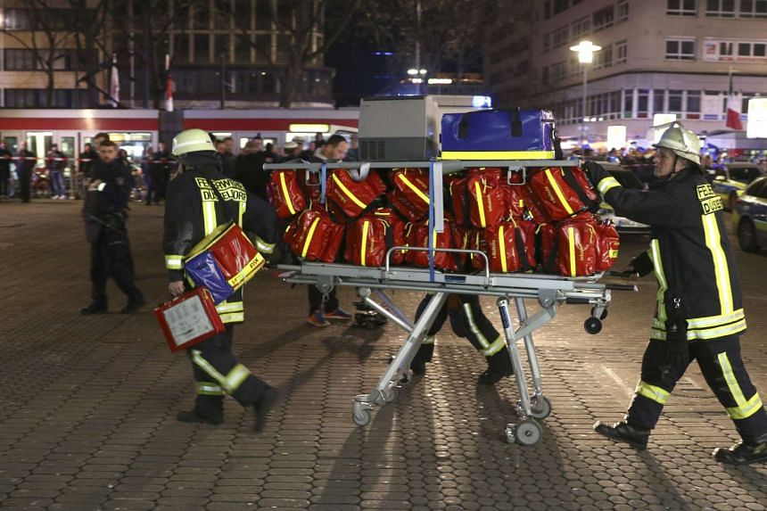 Paramedics of the fire department transport equipment in front of the central station under lockdown in Duesseldorf, Germany.