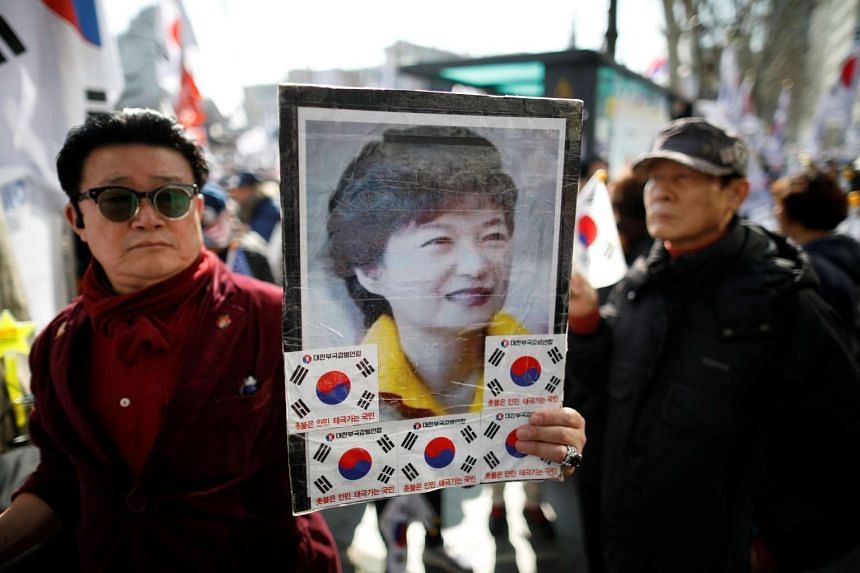 Supporters of South Korean President Park Geun Hye attending a protest before the Constitutional Court ruling on Park's impeachment in Seoul, South Korea.