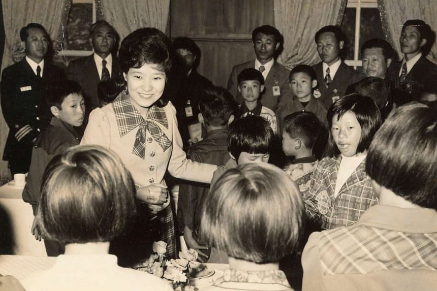 Handout photo of Park Geun Hye meeting children when she served as her father and then-President Park Chung Hee's first lady.