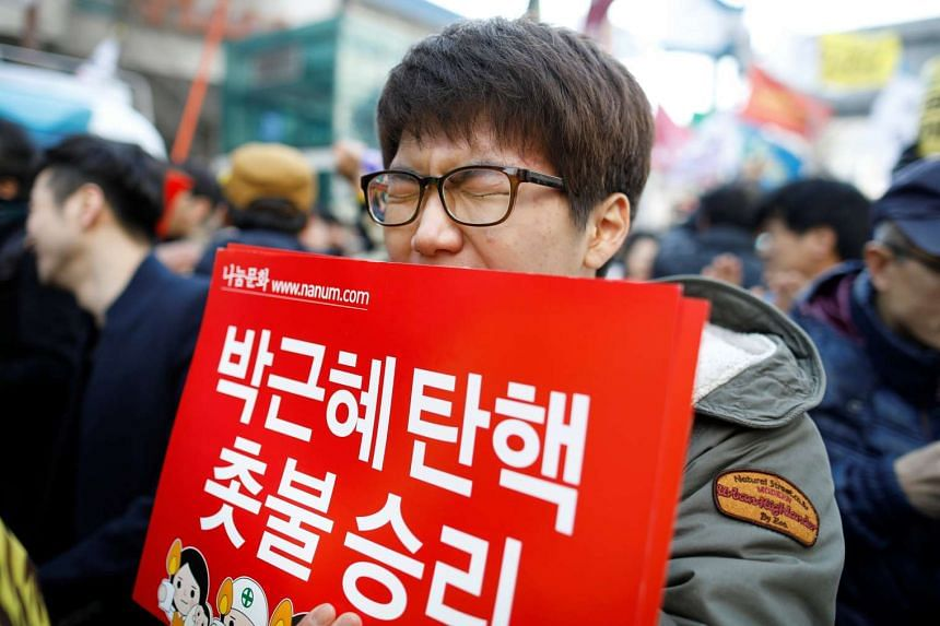 A man reacting after hearing that South Korea's Constitutional Court upheld the impeachment of President Park Geun Hye.
