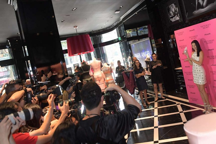Adriana Lima meets the press at the Victoria Secret flagship store in Singapore.