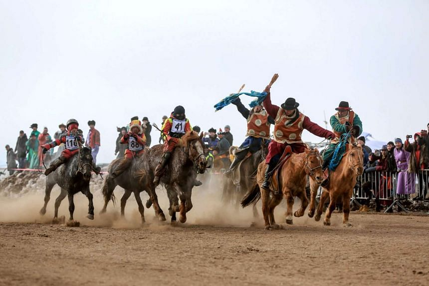 "Mongolian child jockeys competing in the ""Dunjingarav 2017"" spring horse race on the outskirts of Ulan Bator."
