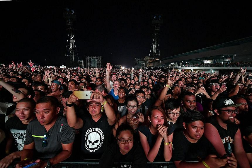 The crowd at American rock band Guns N' Roses' concert at Changi Exhibition Centre last month. Under changes to the Public Order Act introduced in Parliament yesterday, organisers of public events must notify police at least 28 days beforehand if the