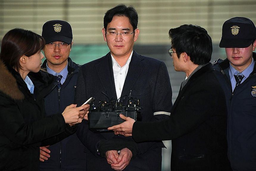 Samsung Group leader Lee Jae Yong arriving for questioning at a special prosecutor's office in Seoul last month. He has been charged with bribery, embezzlement and other offences.
