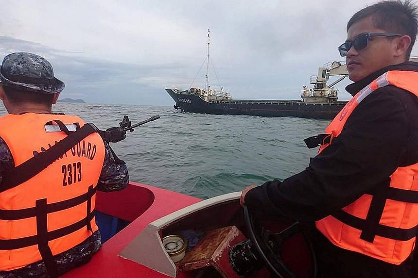 Members of the Philippine Coast Guard escorting Vietnamese vessel MV Giang Hai, which was attacked by pirates, to an anchorage area in Tawi-Tawi in the southern Philippines on Feb 21. According to the Philippine government, the Abu Sayyaf is holding