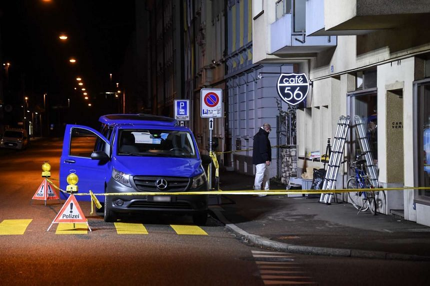 Police securing the site of a shooting in the city of Basel, north-west Switzerland.