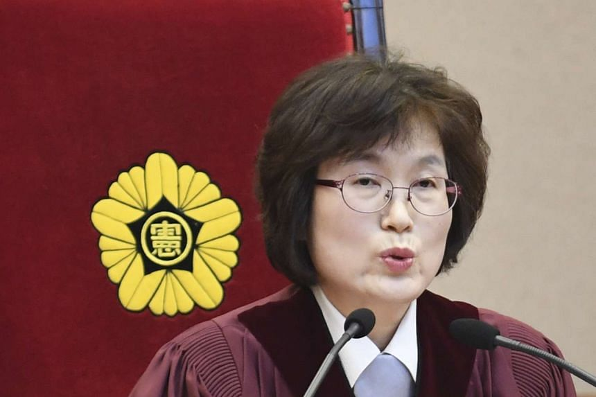Chief Judge Lee Jung Mi speaks during the final ruling of South Korean President Park Geun Hye's impeachment at the Constitutional Court.