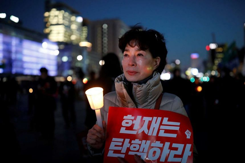 A woman crying during a protest against South Korean President Park Geun Hye.