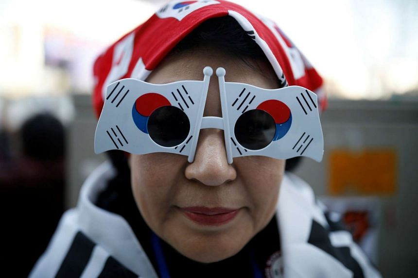 A supporter of South Korean President Park Geun Hye attending a protest near the Constitutional Court in Seoul, South Korea.