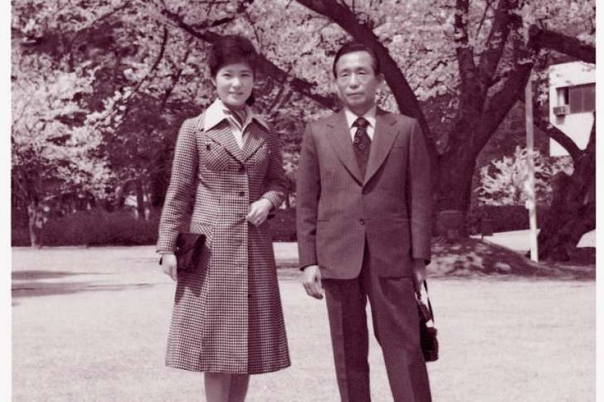 Park Geun Hye (left) poses with her father and then President Park Chung Hee.