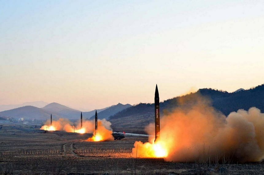 This undated picture released on March 7, 2017, shows the launch of four ballistic missiles by the Korean People's Army (KPA) during a military drill at an undisclosed location in North Korea.
