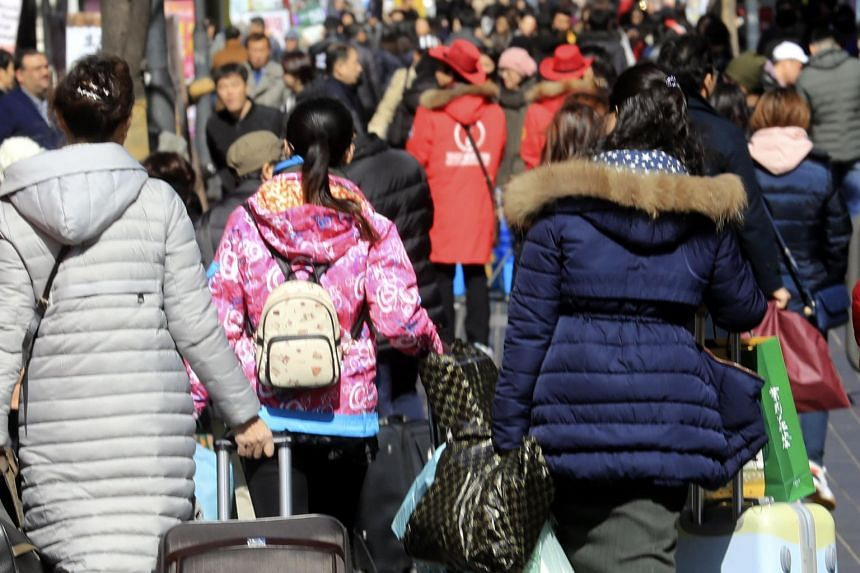 Chinese tourists walking down Myeongdong street in Seoul. South Korea relies heavily on Chinese tourists, who make up nearly half of all foreign visitors, official Korean data show.