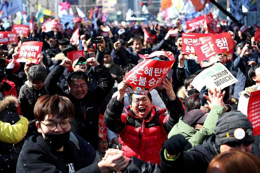 Demonstrators reacting to the decision of the Constitutional Court of Korea to affirm parliament's decision to impeach South Korea President Park Geun Hye on Friday (March 10).