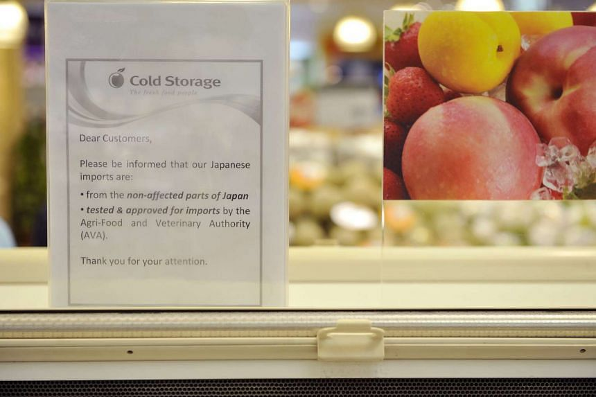 Signs at Cold Storage supermarket in 2011 clarifying that food imports are from safe regions in Japan, and are tested by the Agri-Food and Veterinary Authority of Singapore.