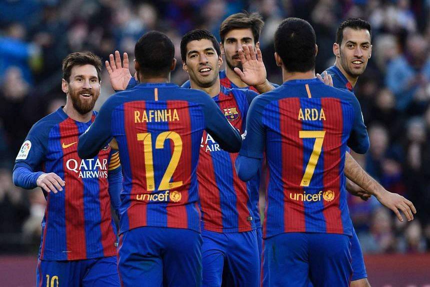 Barcelona's Argentinian forward Lionel Messi (left) celebrates with teamates after scoring a goal in January 2014.