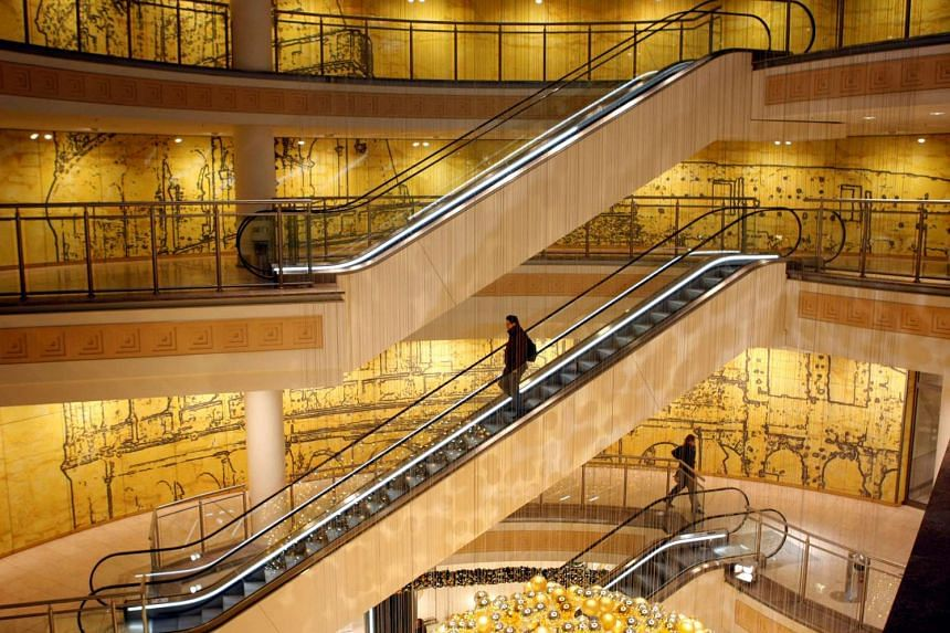 A file photo of a customer using the escalators in a shopping mall in Essen on Dec 2, 2008.