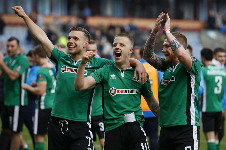 Lincoln City's Alan Power, Terry Hawkridge and Jonathan Jack Muldoon celebrating after a match against Burnley on Feb 18.